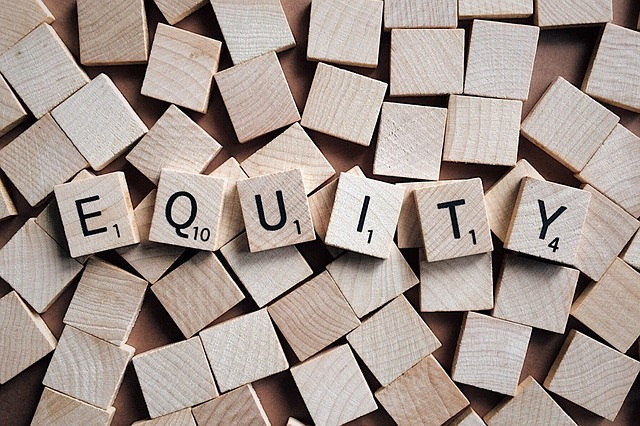 Equity spelled out using Scrabble tiles